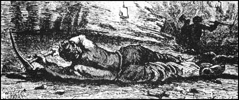 A miner hewing at the coal seam